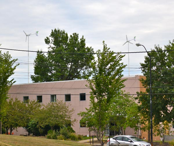 This photo, taken facing east from Wick Avenue, shows the two wind turbines behind Melnick Hall.