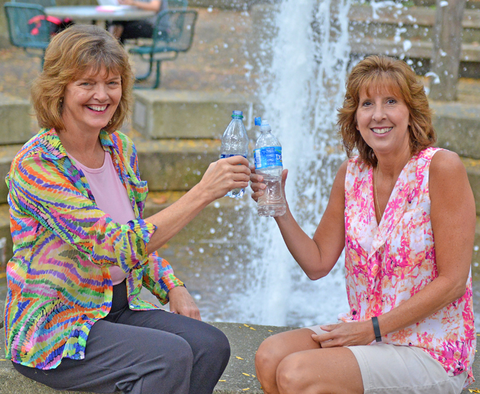 Sharing a water break are Anna Leko, left, computer operator, and Maureen Drabison, programmer analyst. They are among more than 100 YSU employees taking on the Hydrate for Health Challenge.