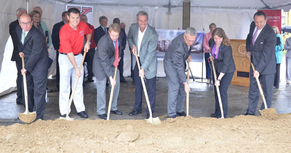 Among those participating in the groundbreaking for the new apartments were, from the left, Youngstown Mayor John McNally; YSU Student Trustee Bryce Miner; Neal McNally, YSU vice president for Finance and Business Operations; Jack Tzagournis, president of Fortress Real Estate Co.; YSU President Jim Tressel; Ashley Orr, YSU Student Government president; and Rick Kirk, principal, Hallmark Campus Communities.
