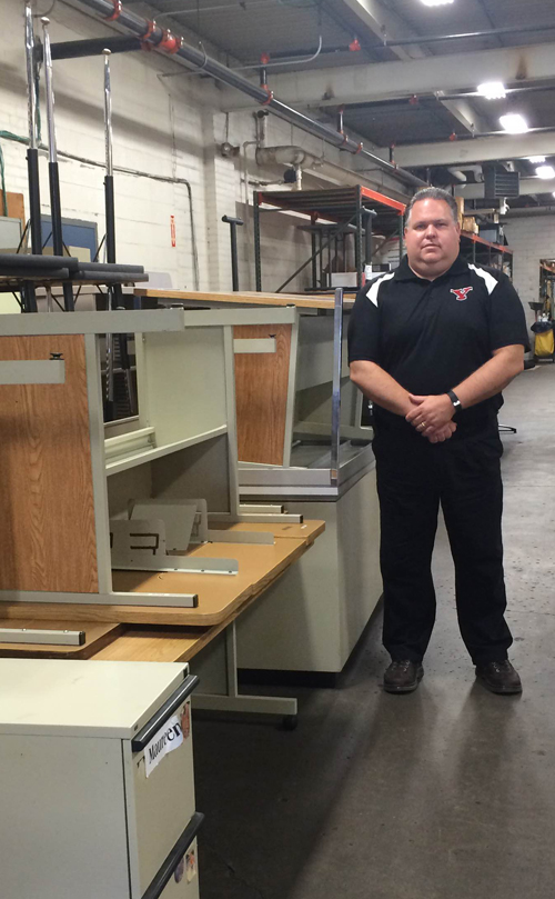 Martyn Moss oversees campus surplus inside the E.J. Salata Complex on Rayen Avenue.