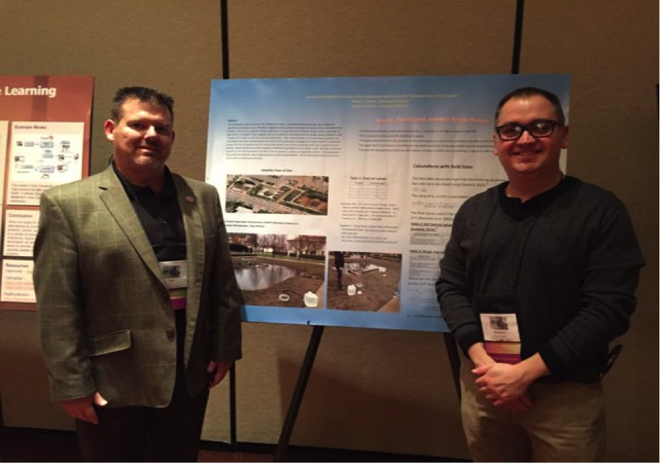 Associate Professor Robert J. Korenic, right, and Joseph Sanson, assistant professor, with their research poster at the American Society of Engineering Education Conference for Industry and Education Collaboration.