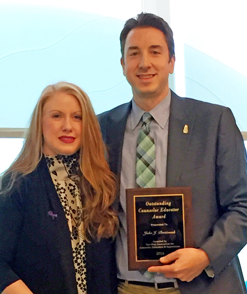 Counselor-Educator of the Year Jake Protivnak, left, celebrates his award with Christie Jenkins, president of the Ohio Association of Counselor Education & Supervision.