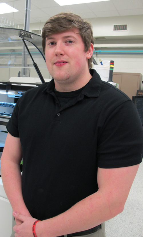 Kyle Myers in a lab in YSU's Moser Hall.
