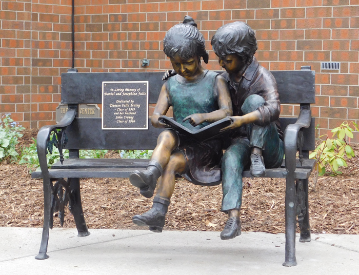 """Two Children on a Bench"" is one of three sculptures donated by YSU alum John Irving and installed on campus this spring. This piece is located near Fedor Hall."