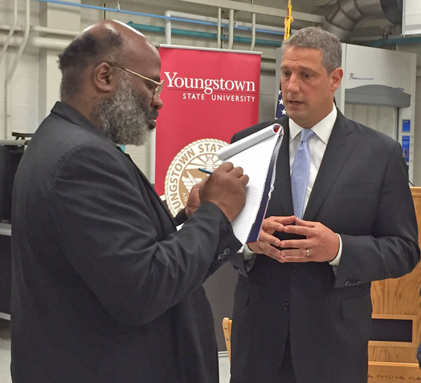 U.S. Rep. Tim Ryan talks with Raymond Smith, reporter with the Tribune Chronicle in Warren, after the news conference in the Center for Innovation in Additive Manufacturing in Moser Hall on the YSU campus.
